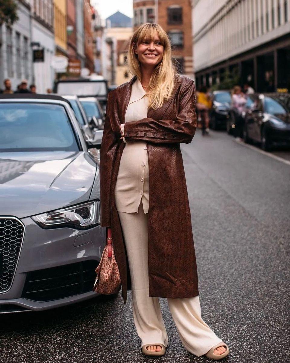 Madsen wear a soft set, brown leather coat and slides